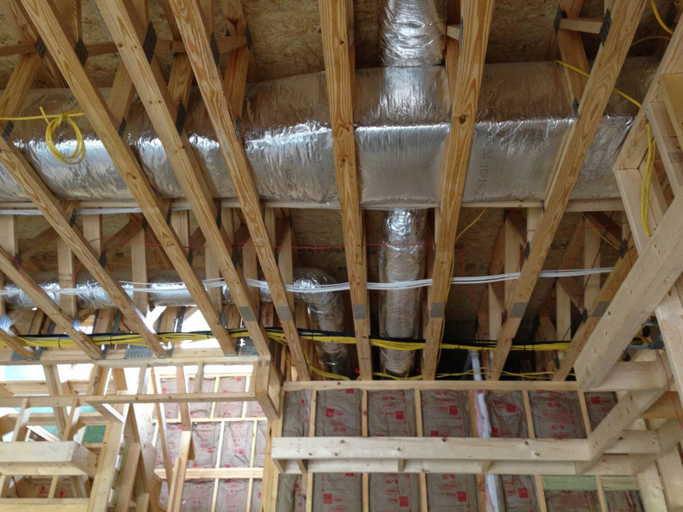 Heat pump and wiring inside a new home construction site showing the tremendous work of Thompson