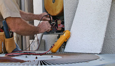 HVAC service being wired and tested on the jobsite by one of the trained professionals from Thompson Electrical