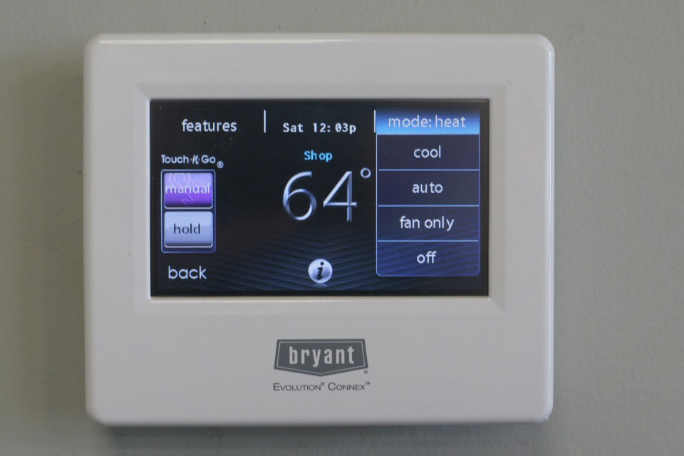 Thermostat for linking a smart home to the HVAC units installed